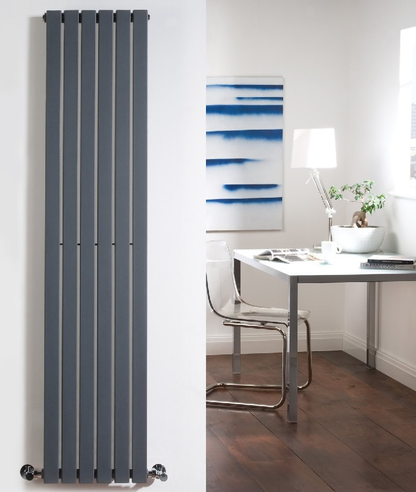 Six panel vertical anthracite radiator on white wall