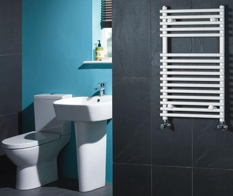 compact white heated towel warmer on black wall