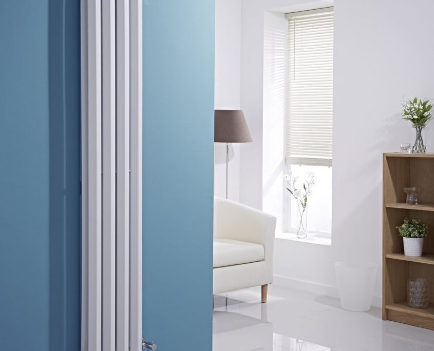 vertical white radiator blue wall