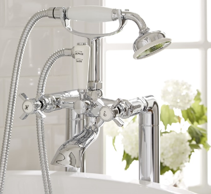 traditional chrome bathtub faucet with white ceramic details