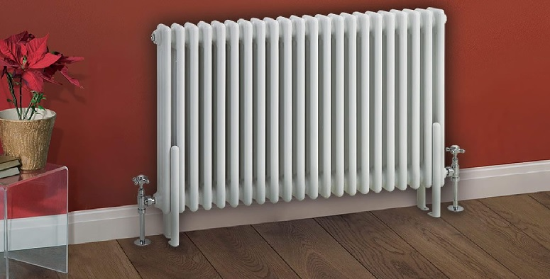 white horizontal radiator in front of red wall